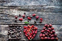 Square, heart, triangle of dried spices on a wooden Royalty Free Stock Image