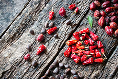 Square, heart, triangle of dried spices on wooden table unusual side view Royalty Free Stock Image