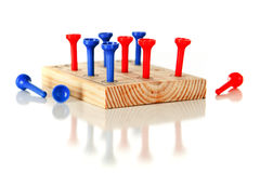 Square 9-hole Pegboard Game Royalty Free Stock Photography