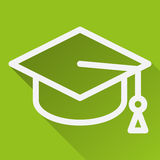 Square icon with image of academic cap, isolated on green.  Stock Photography