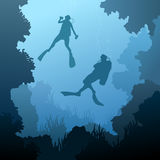 Square illustration of divers under water. Square illustration of scuba divers under water among coral in cave Stock Photo