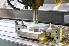 Square industrial metal mold/blank milling. CNC technology. royalty free stock photography