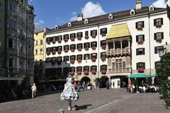 Square in Innsbruck. The golden roof and the live statue at the square in Innsbruck - Austria Stock Photo