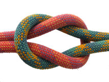 Square knot. Isolated square knot with red and green climbing ropes Stock Images