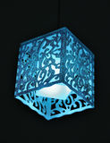 Decorative lighting. A square lampshade with LED light in the black background Royalty Free Stock Photo