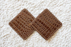 Square leather coaster Royalty Free Stock Images