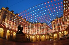Square lights, Turin. Palazzo di Città square at dusk with Christmas artistic lights in Turin, Italy Stock Images