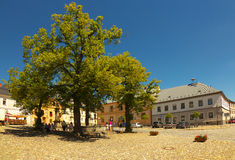 Square with lime tree. Square in Town of Kasperske Hory, Bohemia royalty free stock image
