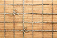 Square lined rope pattern on a wooden background. Texture for nature themes. Stock Photo