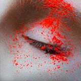 Square macro photo of female eye with neon powder Royalty Free Stock Photography