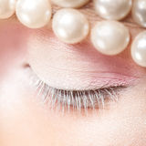 Square macro woman's eye with white and pink makeup colors Stock Image
