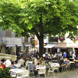 Square in Malcesine. Malcesine, Lake Garda, Italy – 14th September 2015. Popular Square in Malcesine, Lake Garda, Italy, showing crowds eating, drinking and Stock Images
