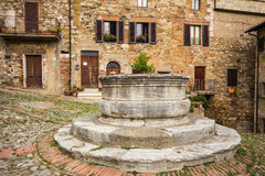 Square of medieval village in Tuscany Stock Photos