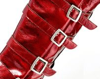 Square metal buckles on red glossy skin Royalty Free Stock Photos