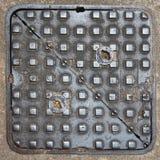 Square metal manhole cover Stock Photos