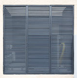 Square metal ventilation grille. On a white wall Royalty Free Stock Photography