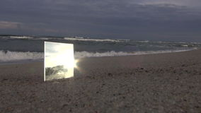 Square mirror on the beach