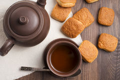 Square mug of tea with shortbread biscuits Stock Image