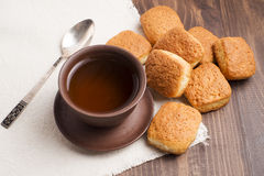 Square mug of tea with shortbread biscuits. On a brown table and a napkin Stock Photography