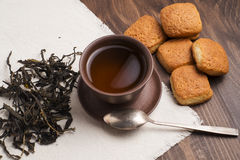 Square mug of tea with shortbread biscuits. On a brown table and a napkin Royalty Free Stock Image