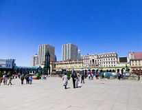 Square near Saint Sophia Church of Harbin. Tourists traveling the square near Saint Sophia Church of Harbin in Heilongjiang province China Royalty Free Stock Images