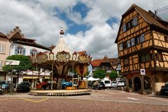A square in Obernai, Alzace France with a carrousel stock image
