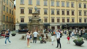 Stockholm, Sweden, July 2018: The square of the old city in the center of Gamla Stan. Many tourists rest here and admire