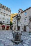 The square with an old Draw Well  in Kotor Stock Photo