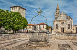 Square in old town Svetvincenat. Square with well, church and castle in old town Svetvincenat, Istria, Croatia stock image