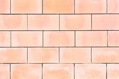 Square orange brick wall background. Royalty Free Stock Photo