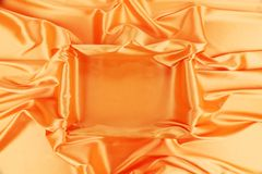Square in orange fabric. Royalty Free Stock Image