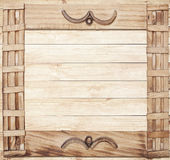 Square ornate wooden frame on wood background Royalty Free Stock Image