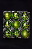 Square packing for glass balls green Royalty Free Stock Photo