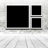 Square Paintings hanging on the art gallery wall Royalty Free Stock Photo