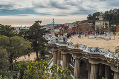 Square in palms in Park Guell, Barcelona, Spain, cloudy. Cloudy in Park Guell square, Barcelona, Catalania Royalty Free Stock Photos