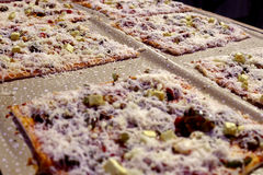 Square pan pizza. Many square pan pizza with cheese are ready to serve on family gathering stock photos