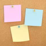 Square paper notes over cork board Stock Photos