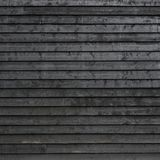 Part of black painted wooden planks of barn wall or shed royalty free stock photography
