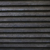 Square part of black wooden fence or part of barn Stock Image