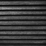 Square part of black wooden fence or part of barn in black and w Stock Images