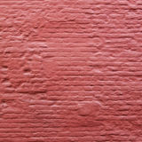 Square part of red painted brick wall Stock Images