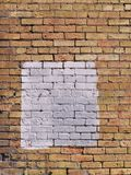 Square patch of white paint on brick wall. Square patch of white paint on an orange and yellow brick wall Royalty Free Stock Photography