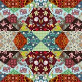 Square patchwork rug with cute animals, flowers and abstract patterns Royalty Free Stock Images