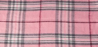 Square pattern fabric background. Textures pink and white cotton fabric. The pattern for textiles. Cell. Shirts plaid. Trendy stock photography