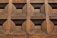 Square pattern on old brown wooden wall.  Stock Image
