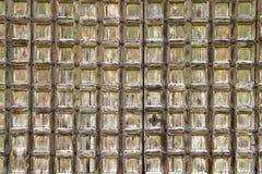 Square pattern worn wooden door background Stock Photo