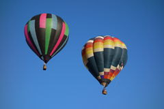 Square patterned hot air balloons, blue sky Stock Photography
