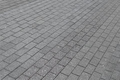 The square or the pavement of granite or marble rectangular tile grey color. royalty free stock photography