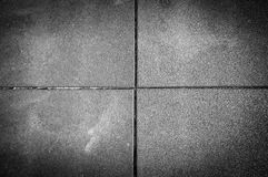 Square pavement tiles in stone concrete Royalty Free Stock Photos
