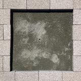 Square pavement tiles stone under construction Stock Photos